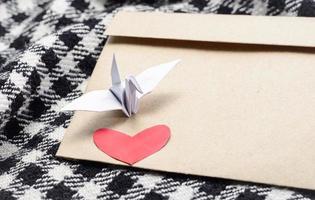 heart and paper bird