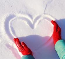 drawing heart on snow
