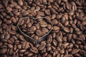 Background of roasted coffee beans and a heart photo