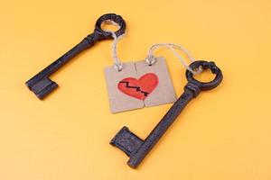 Keys to heart, Conceptual photo. On color background