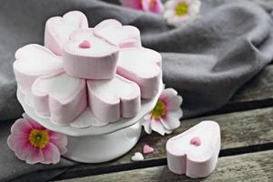 Pink marshmallow on a wooden table