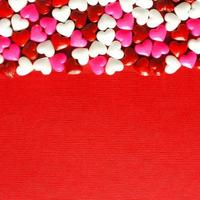 Red Valentines Day background with candy hearts