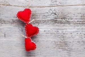 três corações de amor