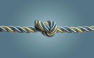 Tied knot on a  rope isolated on blue