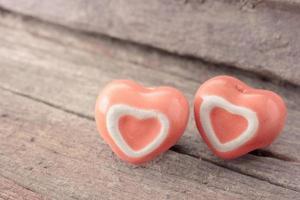 Heart shape ceramic on wooden background.