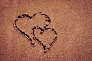 hearts drawn into sand