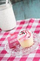 Happy Valentines Day Sign and Iced Cupcake photo