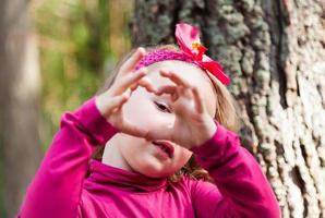 Little girl make heart photo