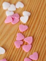 candy hearts wood background