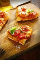 Smalll heart shaped pizzas photo