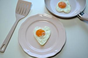 Two heart shaped eggs photo