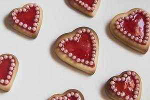 Red hearts cookies on white background photo