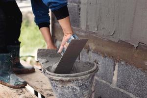 Working with plastering tools and cement
