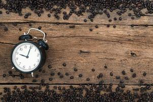 Alarm clock and coffee beans on the desk