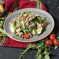 Salad with meat, eggs, and tomatoes