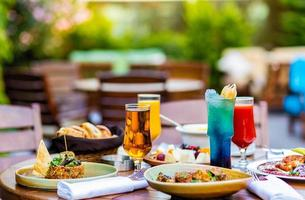 Assorted meals on wooden terrace table