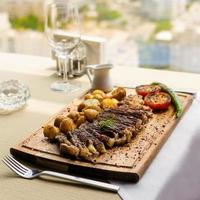 Tasty steak with potato and vegetables
