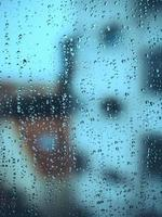 Raindrops on misted glass
