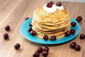 Pancakes with yogurt and cherries