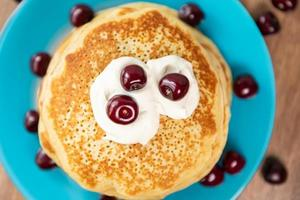 Pancakes with yogurt and cherry