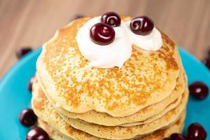 Pancakes with yogurt and cherry topping