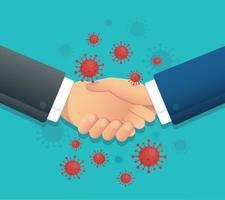 empresarios dándose la mano alrededor de las células del coronavirus