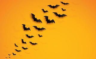 concepto de halloween con murciélagos volando sobre degradado naranja