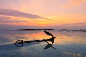 Old anchor in water photo