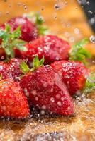 strawberry washed with running water