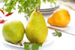 Fresh pears with drops of water