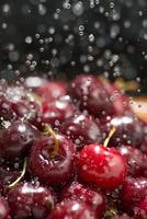 cherries are washed under running water