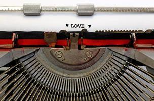 written typewriter LOVE with black ink photo