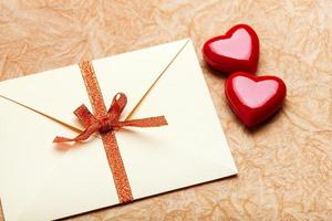 Envelope with valentine card on paper background