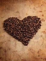 heart fron coffee beans, on wooden surface
