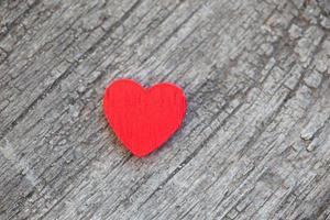 red heart over a wooden background