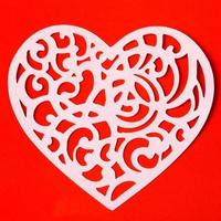 Valentine carving heart on the red paper background