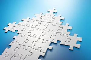Arrow shaped jigsaw puzzle. photo