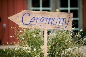 Decorative sign pointing to a wedding ceremony