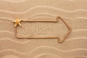 Arrow made of rope  with the word Dubai