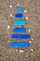 Empty wooden arrows with shells on the beach in Thailand photo