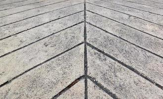 Surface of line concrete floor in soft focusing arrow background photo