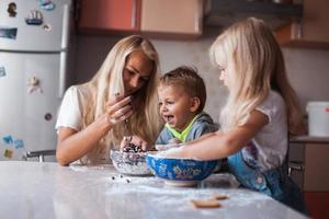 mother and children playing photo