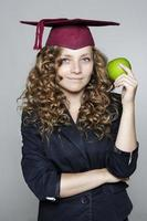 joven estudiante con una manzana foto