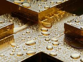Water drops on gold photo