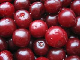 Cherry with water drops - berry background photo