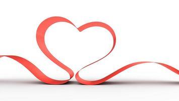 Red ribbon in a heart shape.