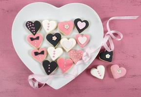 Pink, black and white homemade heart shape cookies