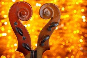 Vintage violin scrolls make heart shape photo
