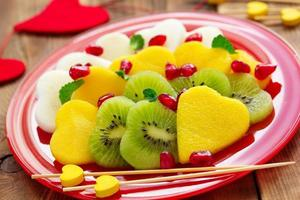 Fruit salad in the form of hearts on Valentine's Day. photo