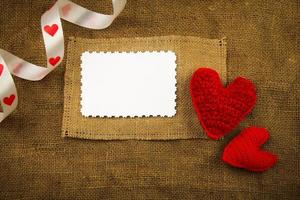 Knitting hearts on the sackcloth photo